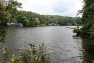 Imagine building a dream home on this wonderful lakefront lot in Highlands NC