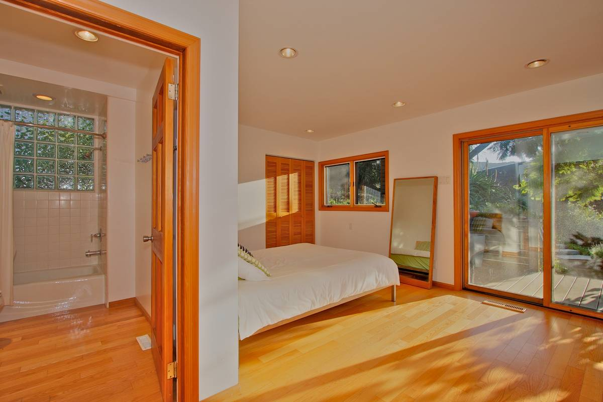 Master bedroom with large slider has outdoor access.