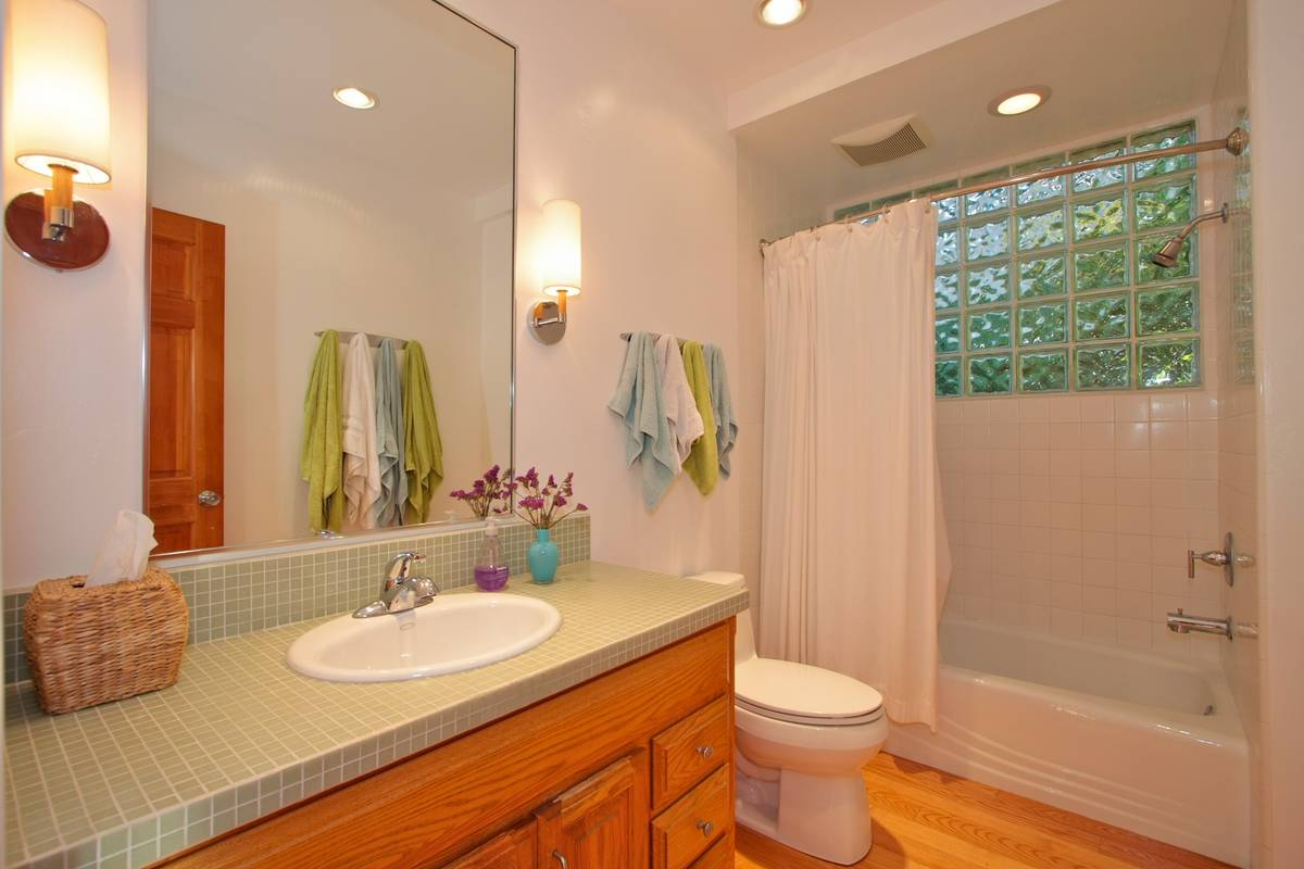 Master bath with glass mosaic counter.